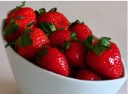 Ripe strawberries in a white bowl